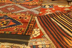 overlapping carpets with intricate kurdish  patterns - stock photo