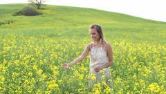 A portrait of a happy woman in yellow rape field - stock footage