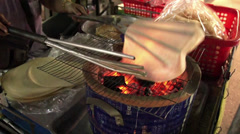 "Thai chapati, roasted flatbread made by flour, thai people call ""kao-kreap-wao"" Stock Footage"