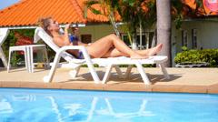 Young Beautiful Woman in Bikini Relaxing on a Deckchair Using Mobile Phone. Stock Footage
