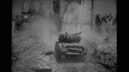 Military tank in debris of damaged buildings Stock Footage