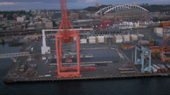 Aerial view CenturyLink Field and Baseball Stadium and docks Seattle, USA Stock Footage