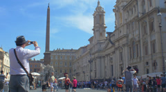 Tourist in Navona square in Rome city center: Italy, Bernini, monument Stock Footage