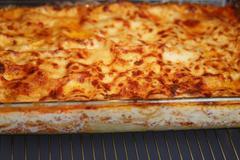 Cooking italian homemade lasagna Stock Photos
