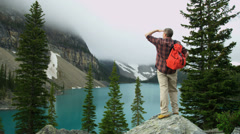 Lake Moraine male hiker Banff National Park, Canada - stock footage