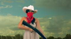 Girl lady shotgun shot gun outlaw Stock Footage