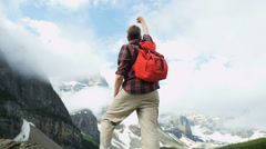 Male hiker enjoying success and achievement Lake Moraine, Canada - stock footage