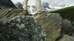 Male hiker enjoying success  Lake Moraine, Canada - stock footage