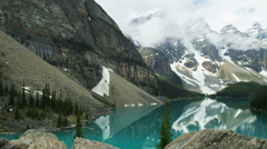 Male hiker viewing turquoise Lake Moraine, Alberta, Canada Stock Footage