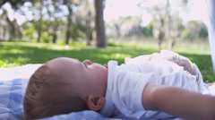 Happy Smiling Baby Playing Blanket Park Grass - stock footage