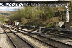 iron railway tracks converging on the north yorkshire moors railway, grosmont - stock photo
