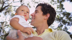 Close up Young Father Holding Toddler Son Outdoors Stock Footage