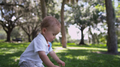 Happy Male Caucasian Toddler Baby Enjoying Outing Park Stock Footage