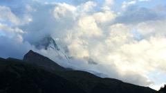Matterhorn motion time lapse cloud formations, Zermatt - stock footage