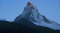 Time lapse morning sunlight dark shadows, Matterhorn, Zermatt Stock Footage
