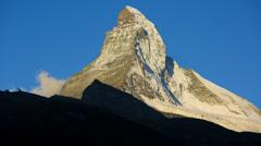 Motion time lapse sun rising Matterhorn, Zermatt Stock Footage