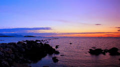 The rocky shore of Andaman Sea at sunset. Koh Samui, Thailand. Video ripples Stock Footage