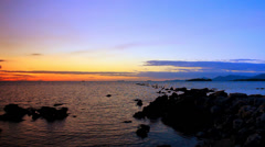 The rocky shore of Andaman Sea at sunset. Koh Samui, Thailand. Video ripples - stock footage