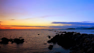 Stock Video Footage of The rocky shore of Andaman Sea at sunset. Koh Samui, Thailand. Video ripples