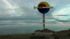 Europe Norway the North Cape 026 direction sign to north with cloudscape behind Stock Footage