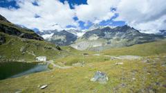 Time lapse panning motion cloudscape lake view, Zermatt Stock Footage