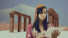 Cleopatra reading read letter Stock Footage
