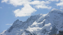 Motion panning time lapse cloud vortices Swiss Alps, Switzerland Stock Footage