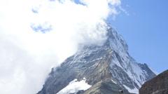 Motion time lapse cloud vortices Swiss Alps, Zermatt Stock Footage