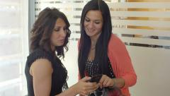 Cute women talking and laughing watching the smartphone: 4k footage Stock Footage