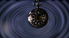Old Pocket Watch Swinging in Slow Motion Stock Footage