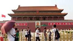 Tourists taking photos in front of Tiananmen Gate Stock Footage