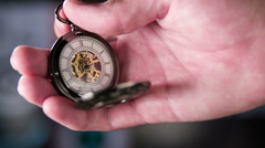 Setting Pocket Watch Ticking in Slow Motion - stock footage