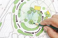 Stock Photo of landscape architect designing on site analysis plans