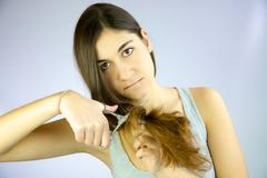 Stock Photo of cute girl ready to cut her long hair