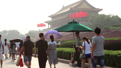 policeman and pedestrians in front of Tiananmen gate - stock footage