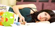 Stock Photo of sad woman depressed about recession and economical crisis