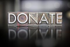 Donate letterpress Stock Photos
