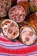 Traditional aspic pieces and sausages Stock Photos