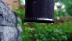 Stock video footage rain water drops downspout slow motion Stock Footage