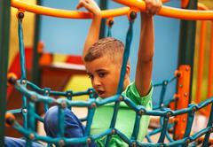 Afro American boy on playground Stock Photos