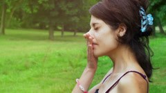 Young girl scratching her face and fingers her nose Stock Footage