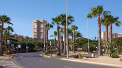 Spain, sea tourist resort La Manga cityscape with palms and blue sky. Stock Footage