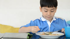 Little asian boy eating fried rice . - stock footage