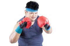overweight man ready to boxing  - stock photo