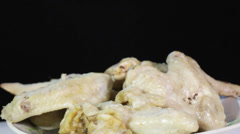 Chicken wings on black Stock Footage