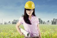 Pretty engineer holding blueprint  Stock Illustration