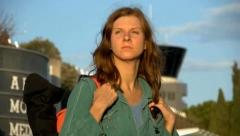 HD1080p50 Young Woman Tourist With Backpack at the Airport looking around. Part Stock Footage