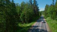 Stock video footage flying over forest road machine  Stock Footage