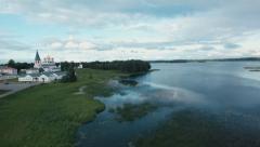 Stock video footage flying over Lake Valdai monastery Stock Footage
