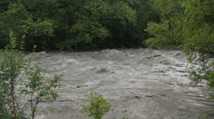 Flood river viewed from riverbank. Turbulent water. - stock footage